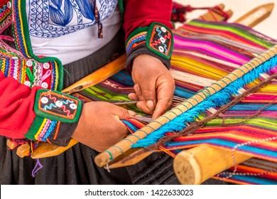 Peruvian woman working on traditional handmade wool production