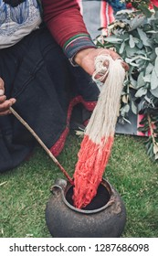 Peruvian women dies natural wool created from sheep and alpaca. Organic fibers are handmade and then the raw fiber are colored in bright red natural dyes with plants. Process using natural resources.