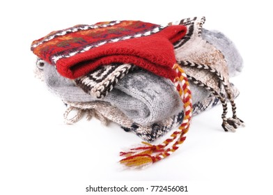 peruvian woolen hat on pullover isolated on white background