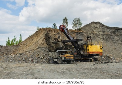 PERVOURALSK, RUSSIA - JUNE 06, 2017: Development of a quarry for extraction of silica refractory rock. BelAZ truck loading