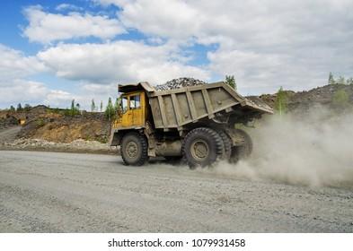 PERVOURALSK, RUSSIA - JUNE 06, 2017: BelAZ truck transports ore on a dirt road