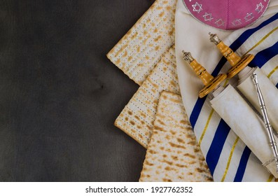 Pesach Israeli matzah bread for Jewish holiday with holy religious book in the torah scroll