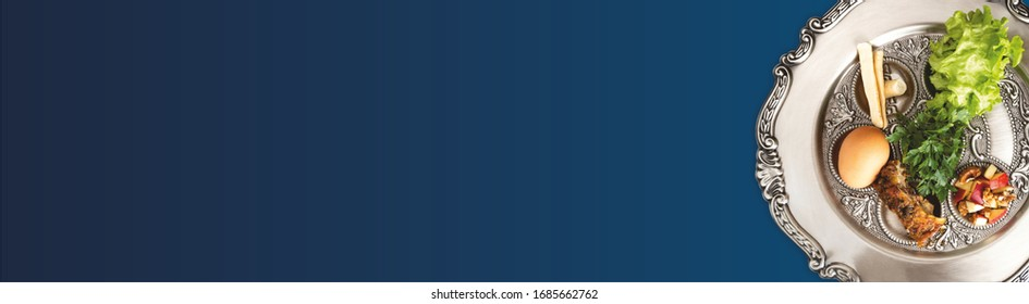 Pesach plate on a dark blue background, wide banner with a copyspace. Traditional Jewish seder on the occasion of Passover festival.