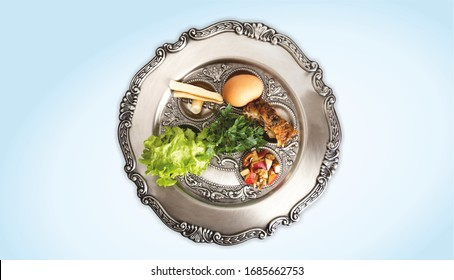 Pesach plate, on a light blue background. Traditional Jewish seder on the occasion of Passover festival.