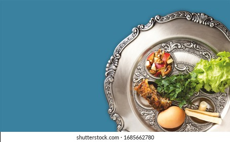 Pesach plate on a petrol blue background. Traditional Jewish seder on the occasion of Passover festival.