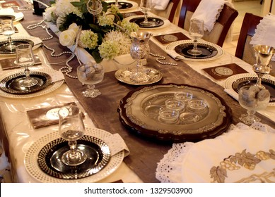 Pesach, Seder table with decorations for wine and Haggadot