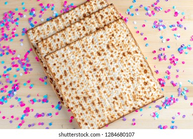 Pesah celebration concept Jewish Matzah bread on wooden table. Passover holiday concept.