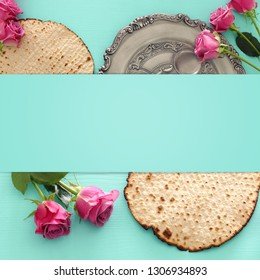 Pesah celebration concept (jewish Passover holiday) over wooden mint background. Top view, flat lay