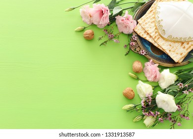 Pesah celebration concept (jewish Passover holiday) over green background. top view flat lay