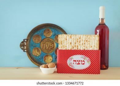 Pesah celebration concept (jewish Passover holiday). Translation for Hebrew Text over plate: (PESAH) PASSOVER, and Matzah utensils text: Matzah