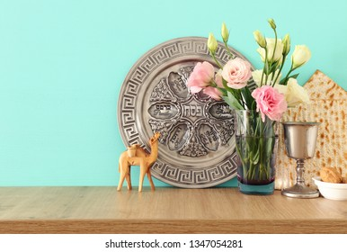 Pesah celebration concept (jewish Passover holiday). Translation for Hebrew Text over plate: (PESAH) PASSOVER