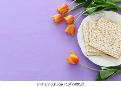 Pesah celebration concept (jewish Passover holiday). Translation for Hebrew Text over plate (Pesah) Passover