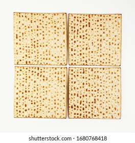 Pesah celebration concept - jewish Passover holiday Four Square Folded Matzo Isolated on White Background. View from above. Flat lay