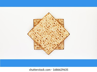 Pesah celebration concept - jewish Passover holiday. Background matzo on a white-blue background. View from above. Flat lay. Copy space.