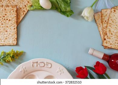 Pesah celebration concept (jewish Passover holiday) with wine and matza