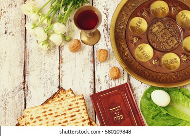 Pesah celebration concept (jewish Passover holiday). Traditional pesah plate text in hebrew: Passover, horseradish, celery, egg, bone, maror, charoset
