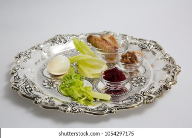 Pesah celebration Passover holiday seder. Traditional pesah plate. Text in hebrew: Passover fairytale.