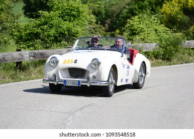 PESARO COLLE SAN BARTOLO , ITALY - MAY 17 - 2018 : TRIUMPH TR 2 SPORTS 1954  on an old racing car in rally Mille Miglia 2018 the famous italian historical race (1927-1957)