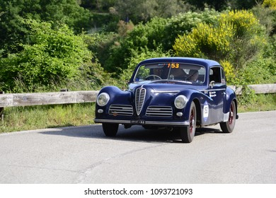 "PESARO COLLE SAN BARTOLO , ITALY - MAY 17 - 2018 :  ALFA ROMEO 6C 2500 SPORT ""FRECCIA D'OR	1948 on an old racing car in rally Mille Miglia 2018 the famous italian historical race (1927-1957)"