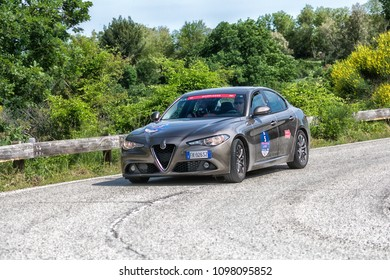 PESARO COLLE SAN BARTOLO , ITALY - MAY 17 - 2018 : ALFA ROMEO GIULIA old racing car in rally Mille Miglia 2018 the famous italian historical race (1927-1957)