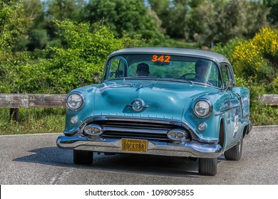 PESARO COLLE SAN BARTOLO , ITALY - MAY 17 - 2018 : OLDSMOBILE SUPER 88	1954 old racing car in rally Mille Miglia 2018 the famous italian historical race (1927-1957)