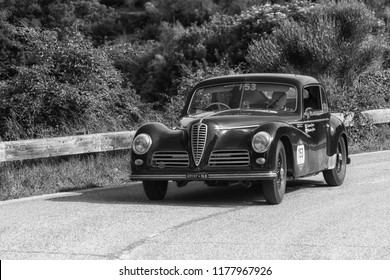 """PESARO COLLE SAN BARTOLO , ITALY - MAY 17 - 2018 : ALFA ROMEO 6C 2500 SPORT """"FRECCIA D'OR1948 on an old racing car in rally Mille Miglia 2018 the famous italian historical race (1927-1957)"""