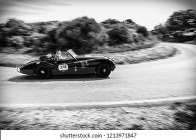 PESARO COLLE SAN BARTOLO, ITALY - MAY 17 - 2018:  JAGUAR XK 120 DHC 1953 old racing car in Mille Miglia rally 2018 the famous italian historical race (1927-1957)