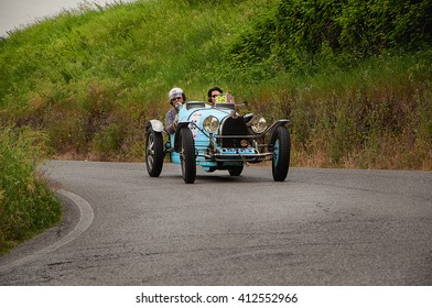 Pesaro, Italy - May 15, 2015: BUGATTI T 51 1933  in nidentified crew on an old racing car in rally Mille Miglia 2015 the famous italian historical race (1927-1957)