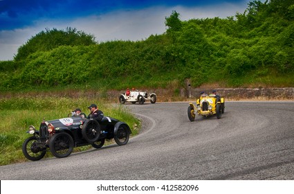 Pesaro, Italy - May 15, 2015: BUGATTI T 23 1923: in nidentified crew on an old racing car in rally Mille Miglia 2015 the famous italian historical race (1927-1957)