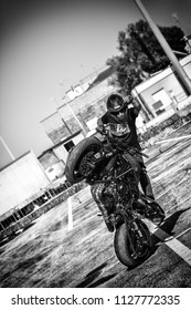 PESARO PORTO , ITALY - JUNE 13 - 2018 : Moto Performance. Tricks on a motorcycle. Smoke.