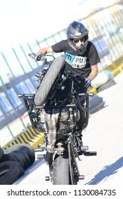PESARO PORTO , ITALY - JUNE 13 - 2018 : Moto Performance. Tricks on a motorcycle. Smoke