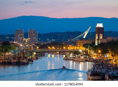Pescara, Italy - 18 August 2018 - The view in the dusk from Ponte del Mare monumental bridge in the canal and port of Pescara city, Abruzzo region.