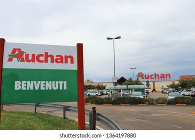 """Pescara, Italy. April 2019. Signboard of the famous French chain of supermarket """" Auchan """". In Italian is written """"Welcome""""."""