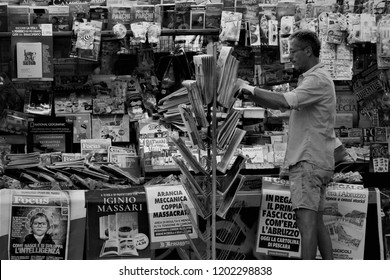 Pescara, Italy - September 2018. Newsagent sets up the newspapers before the opening of the working activity.