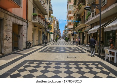Pescara, Italy-July 3, 2014: People walk on street of Pescara, Abruzzo, Italy.