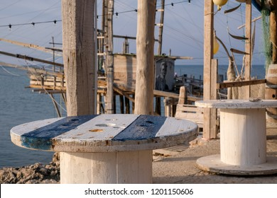 Peschici Italy, September 2018.  Trabucco Da Mimi, traditional wooden structure used for fishing found on the Adriatic coast between Peschici and Vieste. The trabucco has a fish restaurant attached.