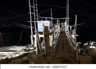 Peschici Italy, September 2018.  Trabucco Da Mimi at night, traditional wooden structure used for fishing found on Adriatic coast between Peschici and Vieste. Trabucco has a fish restaurant attached.