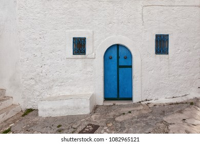 Peschici (Puglia, Italy) - View of the little picturesque village in south Italy with its colored doors