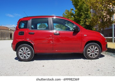 Peschiera del Garda, Italy - August 12, 2017: Red damaged Fiat Panda parked on a public parking lot in the city of Peschiera del Garda. Nobody in de vehicle.