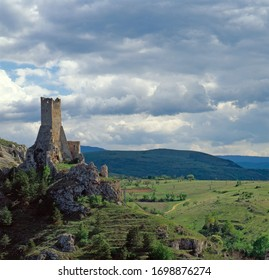 Pescina, Italy, May 2015: the medieval Piccolomini tower stands on a rock bastion guarding the hills near the town of Pescina, on the edge of the Piana del Fucino, in the province of L'Aquila, Italy.