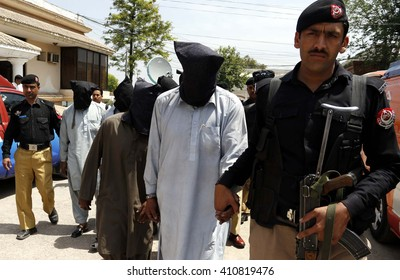 PESHAWAR, PAKISTAN - APR 25: Police officials show arrested six suspects who involved in killing of special advisor to chief minister Soran Singh during press conference on April 25, 2016 in Peshawar.