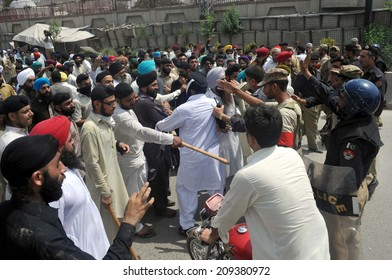 PESHAWAR, PAKISTAN - AUG 06: Sikh community is protesting against assassination of their people by unknown assailant as they are demanding to provide complete rights  on August 06, 2014 in Peshawar.