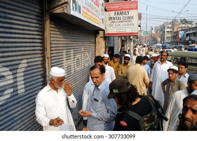 PESHAWAR, PAKISTAN - AUG 19: Assistant Commissioner (ACO) close illegal  dental clinics during crackdown campaign against encroachments and unregistered dental clinics on August 19, 2015 in Peshawar.