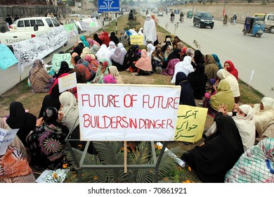 PESHAWAR, PAKISTAN - FEB 09: Veiled women members of Frontier Education Foundation (FEF) are protesting in favor of their demands during demonstration  on February 09, 2011in Peshawar.
