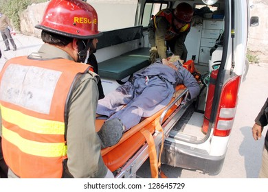 PESHAWAR, PAKISTAN - FEB 18: Victim of political agent office bombs blast being shifted at Lady Reading Hospital for treatment, on  February 18, 2013 in Peshawar. Atleast five persons were killed