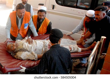 PESHAWAR, PAKISTAN - FEB 21: Injured victims of suicide bomb explosions that occurred at a local court building in Charsadda, being shifting for treatment to LDH on February 21, 2017 in Peshawar.