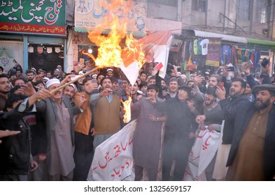 PESHAWAR, PAKISTAN - FEB 27: Members of Anjuman-e-Tajran burn Indian flag as they are holding protest demonstration against Indian Government, at Qissa Khuwani Bazar February 27, 2019 in Peshawar.