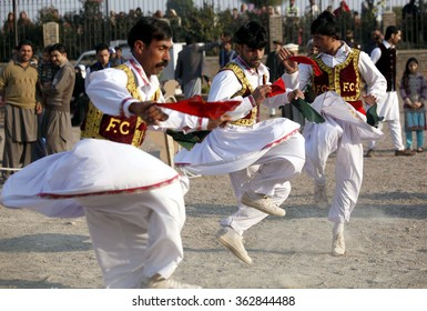 PESHAWAR, PAKISTAN - JAN 15: Artists are performing folk dance during to entertain  visitors of three days ??Handicrafts Festival?� arranged by Tourism Corporation on January 15, 2016 in Peshawar.