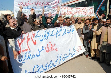 PESHAWAR, PAKISTAN - JAN 18: Members of All Pakistan Clerks Association (APCA) shout slogans for the implement on timescale during protest demonstration on January 18, 2012 in Peshawar.