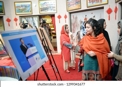 PESHAWAR, PAKISTAN - JAN 29: Visitors take keen interest in pictures during Chinese Photos Exhibition held at China Window Centre on January 29, 2019 in Peshawar.